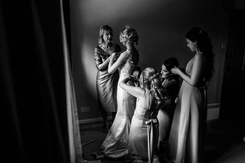 lake district documentary wedding photographer bride getting ready at home black and white