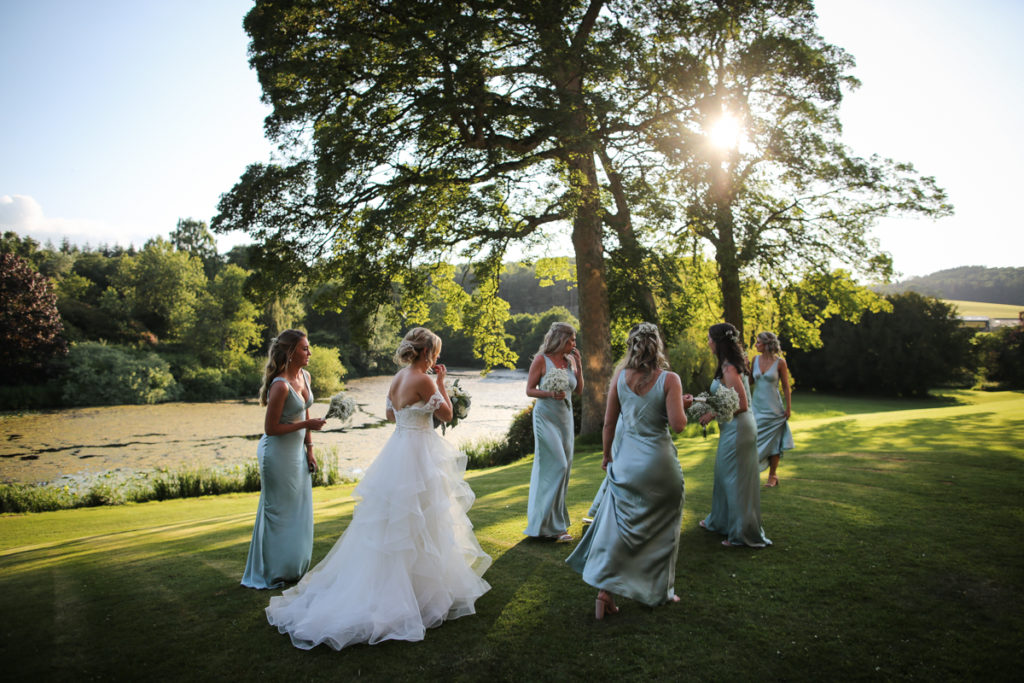 lake district documentary wedding photographer Greystoke Castle bridesmaids in the late summer sun with lake