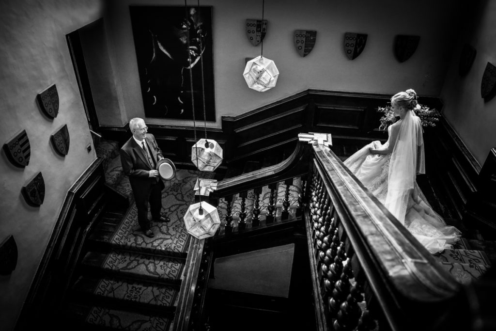lake district documentary wedding photographer Askham Hall bride and father on the stairs