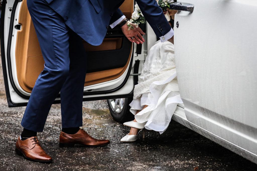 lake district documentary wedding photographer brides feet and car