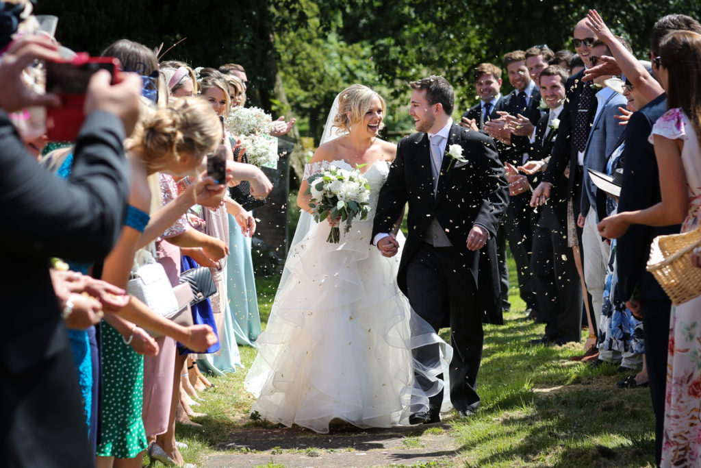 lake district documentary wedding photographer couple and confetti