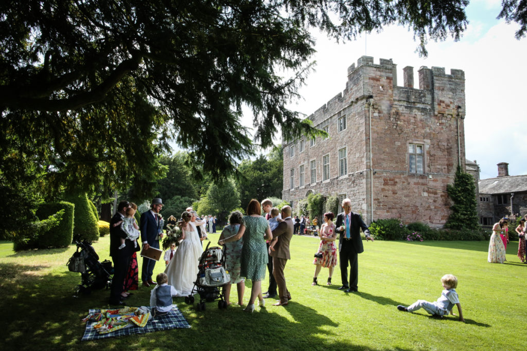 lake district documentary wedding photographer Askham Hall guests on the lawn