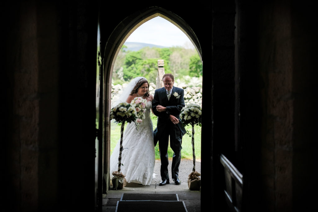 lake district documentary wedding photographer brides entrance into the church