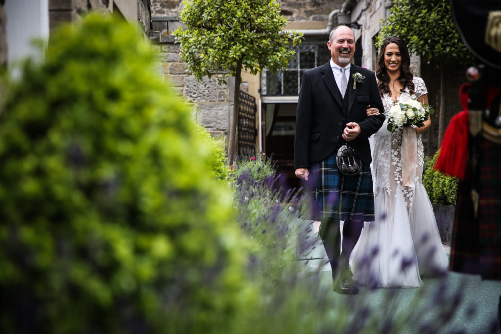 lake district documentary wedding photographer Dundas Castle father and bride walking