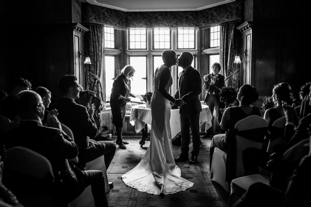 lake district documentary wedding photographer Holbeck Ghyll couple kissing in black and white