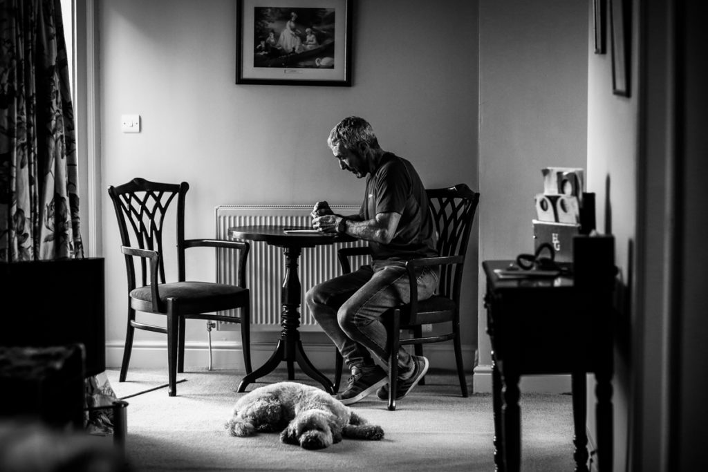 lake district documentary wedding photographer groom writing his speech in black and white