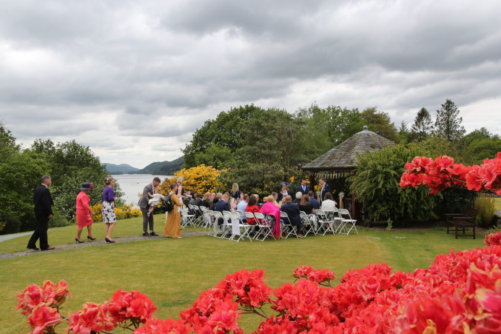 lake district documentary wedding photographer Cragwood wedding guests in the pretty summer gardens