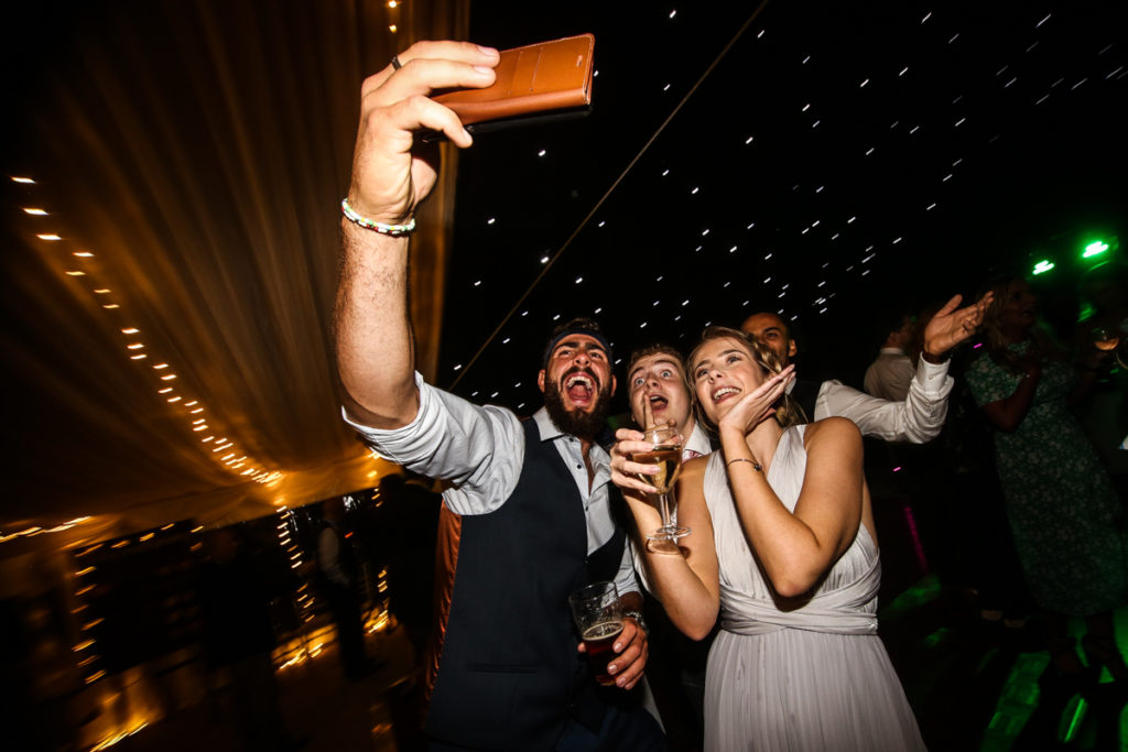 lake district documentary wedding photographer guests dancing