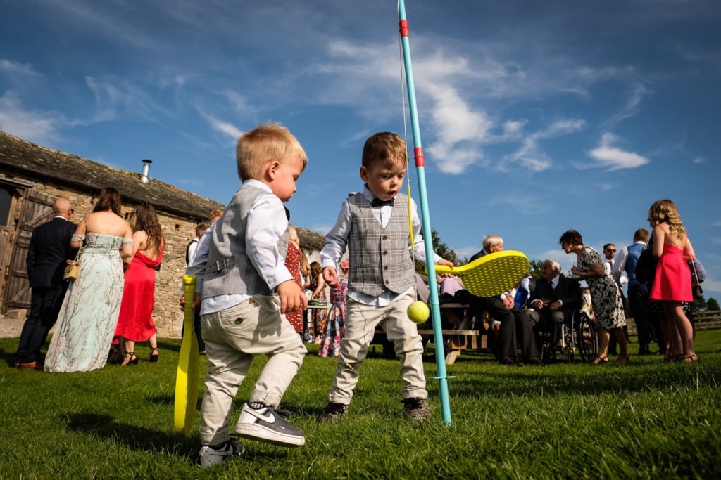 lake district documentary wedding photographer kids playing swing ball at a wedding