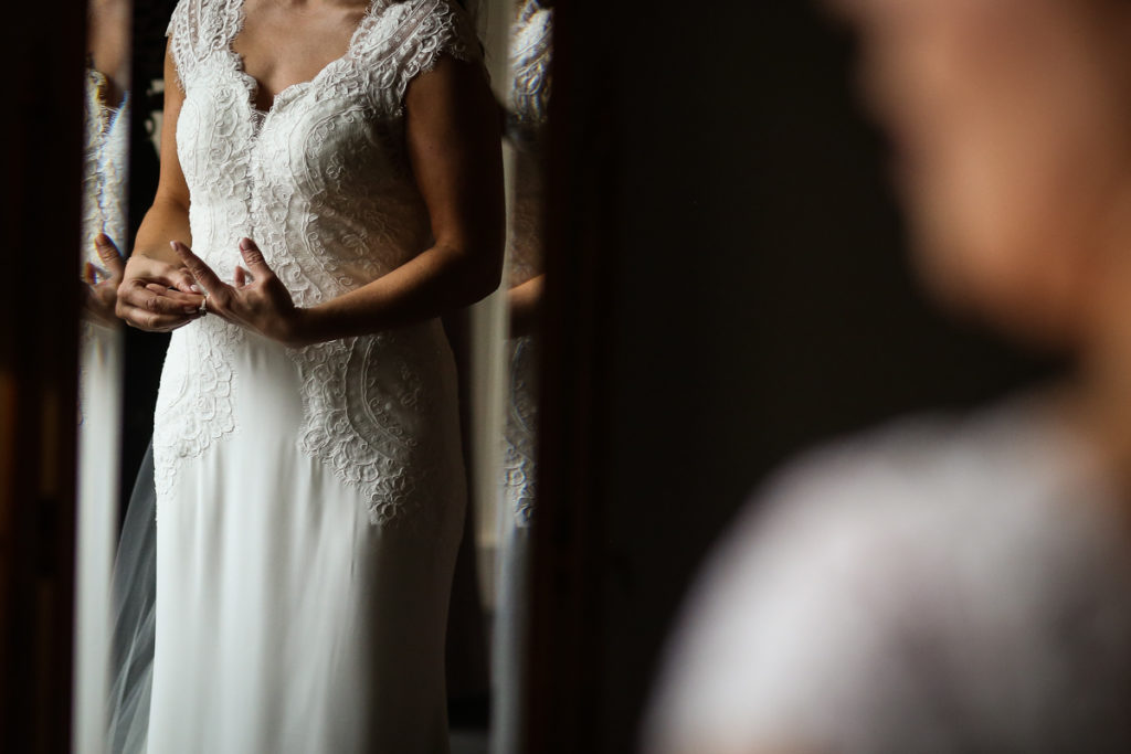lake district documentary wedding photographer brides hands in mirror