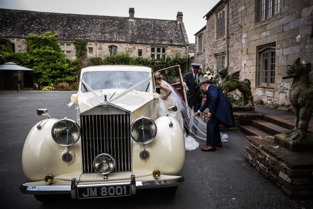 lake district documentary wedding photographer Askham Hall bride leaving in vintage rolls royce