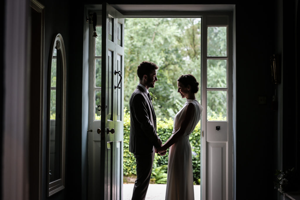 lake district documentary wedding photographer Melmerby Hall couple in door silhouette
