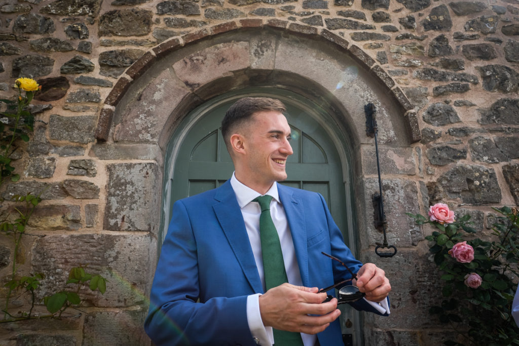 lake district documentary wedding photographer groom in door