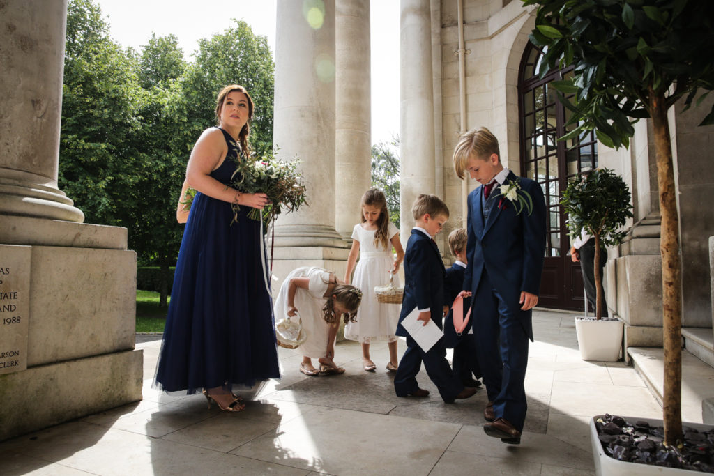lake district documentary wedding photographer Ashron Memorial bridesmaids and pageboys on steps
