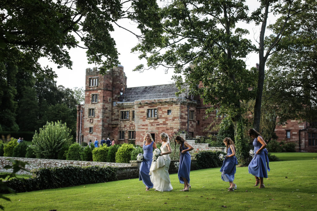 lake district documentary wedding photographer Dalston Hall bride and bridesmaids walking