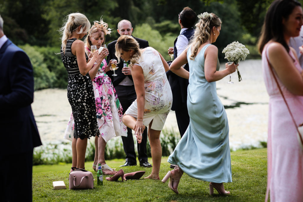 lake district documentary wedding photographer Greystoke Castle wedding guests on lawn