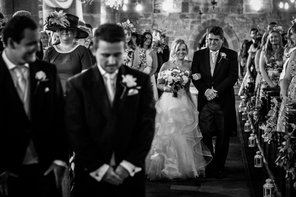 lake district documentary wedding photographer church bride and father walking up the aisle