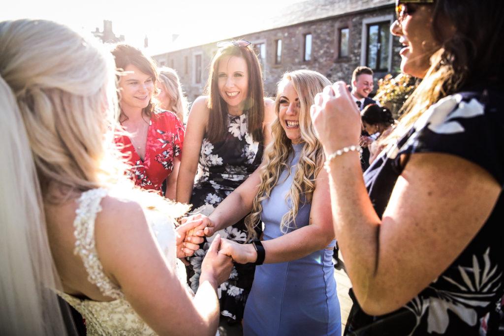 lake district documentary wedding photographer Armathwaite Hall wedding guests laughing