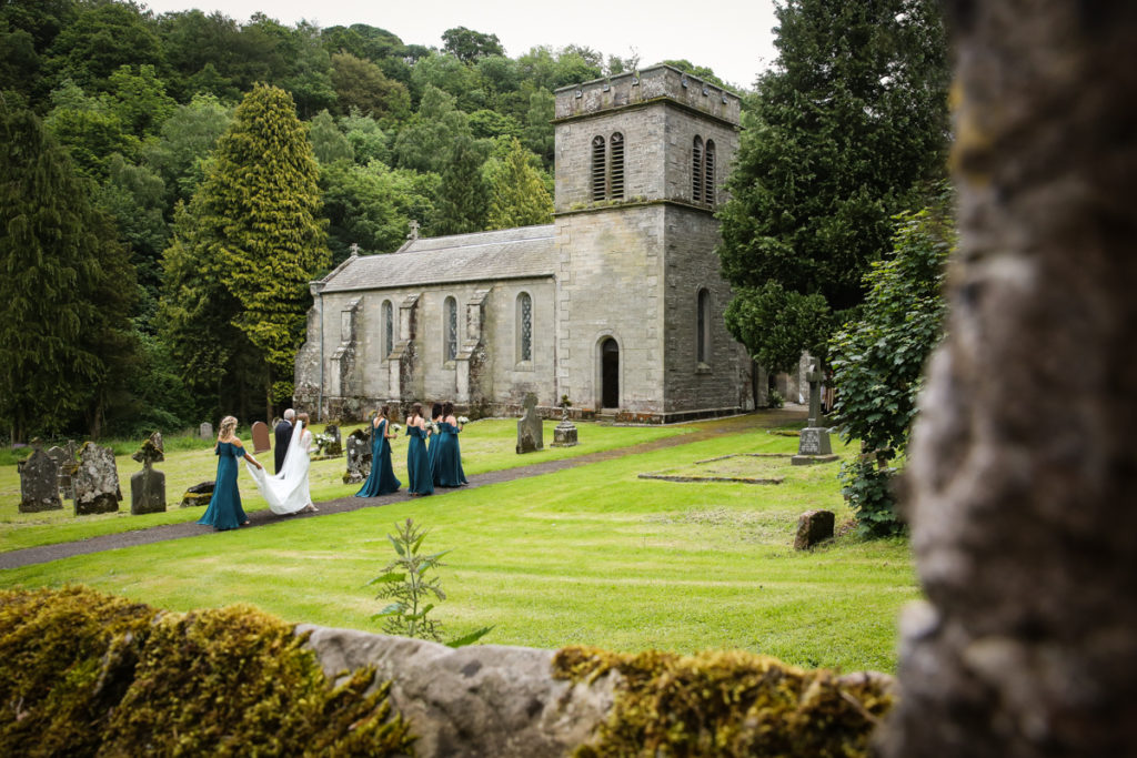 lake district documentary wedding photographer Askham Church wedding party arriving