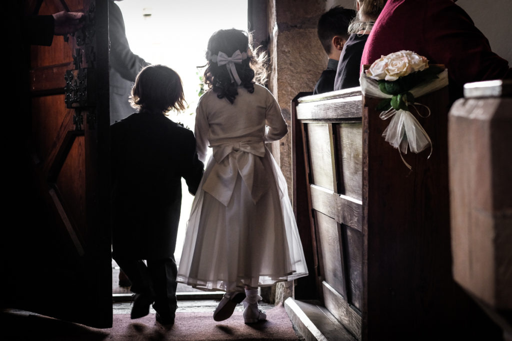 lake district documentary wedding photographer flower girl and page boy in church door