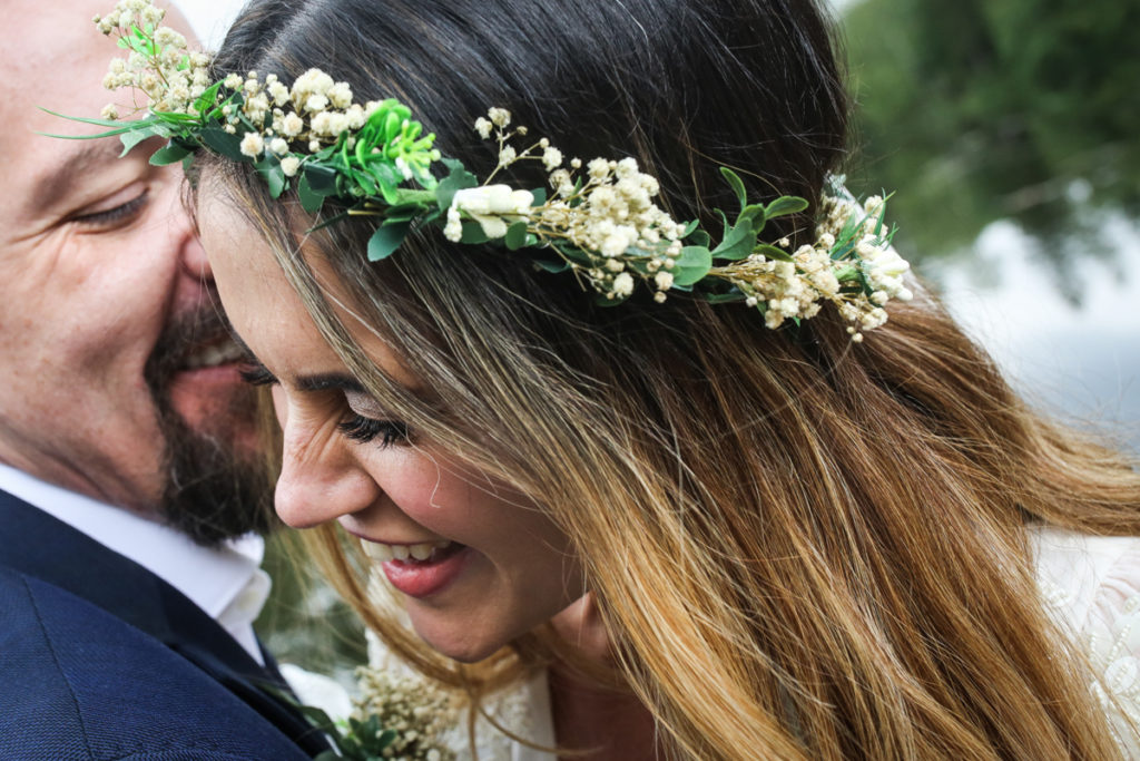 lake district documentary wedding photographer close up of couple laughing