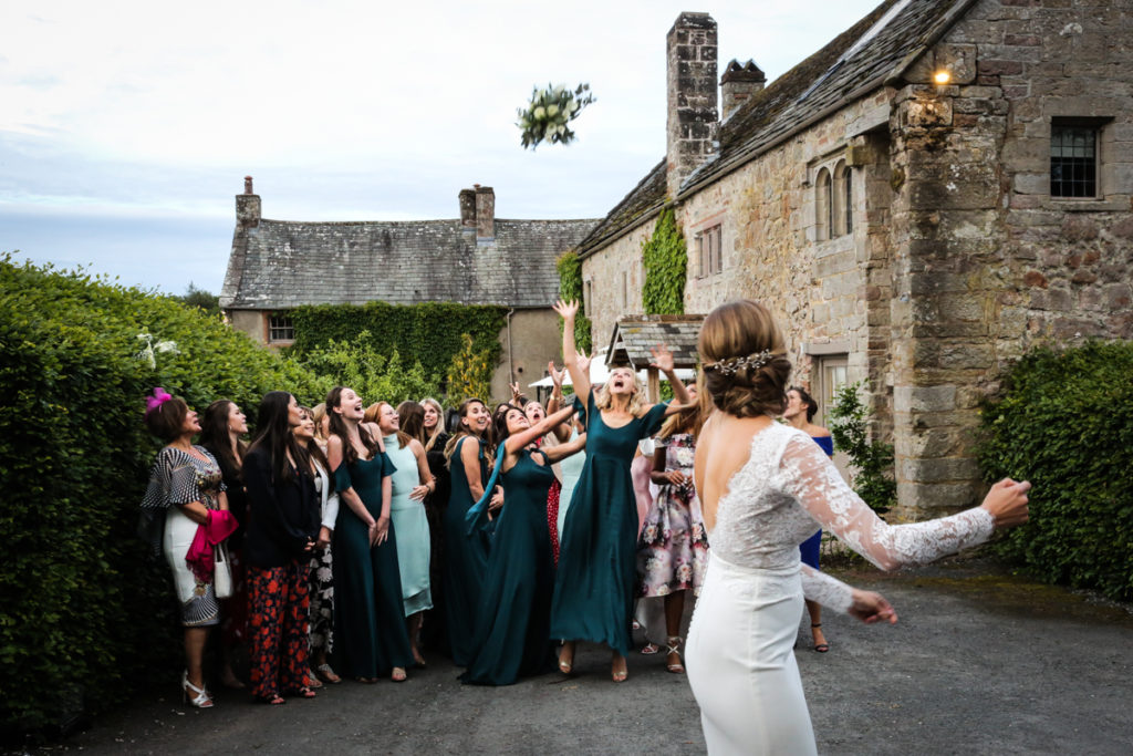 lake district documentary wedding photographer Askham Hall throwing the bouquet