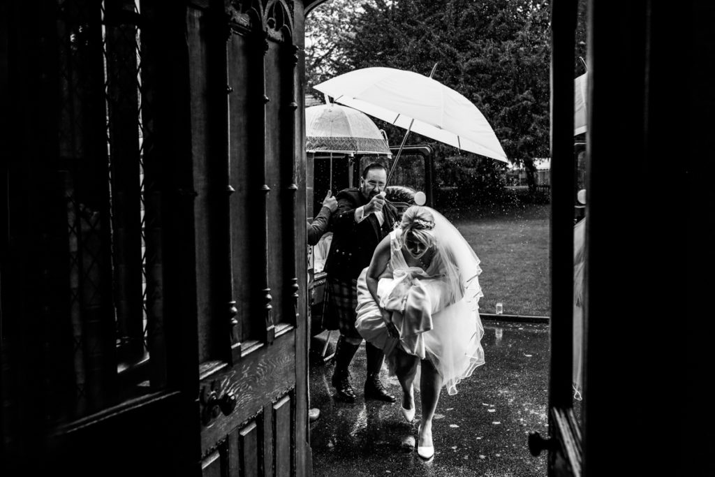 lake district documentary wedding photographer Samlesbury Hall bride arriving in the rain