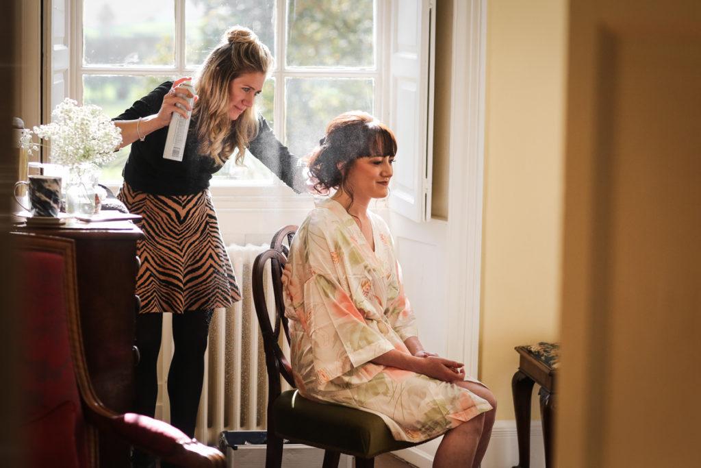 lake district documentary wedding photographer Belmount Hall bride and hairspray