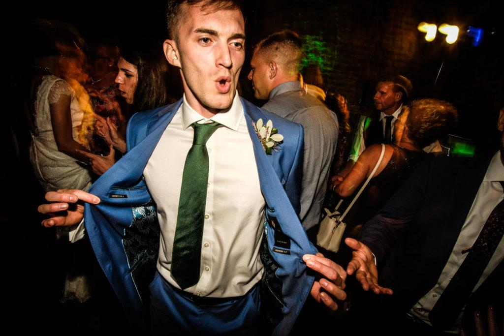 lake district documentary wedding photographer groom dancing