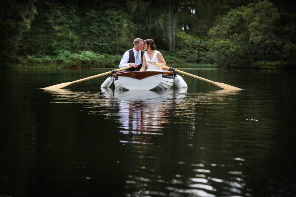 Elopement wedding photographer boat Gilpin Lake house